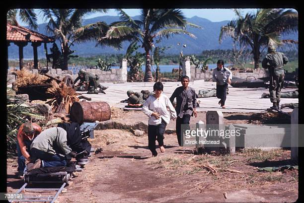 Actors run during the filming of Apocalypse Now April 28 1976 in the Philippines The movie directed by Francis Ford Coppola and based on the book...