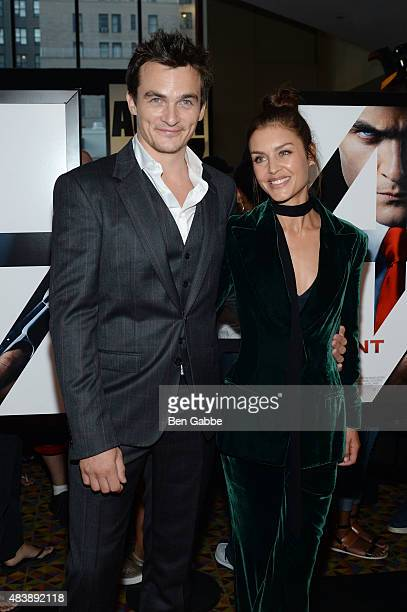 "Actors Rupert Friend and Hannah Ware attend the New York premiere of ""Hitman Agent 47"" at AMC Empire 25 theater on August 13, 2015 in New York City."