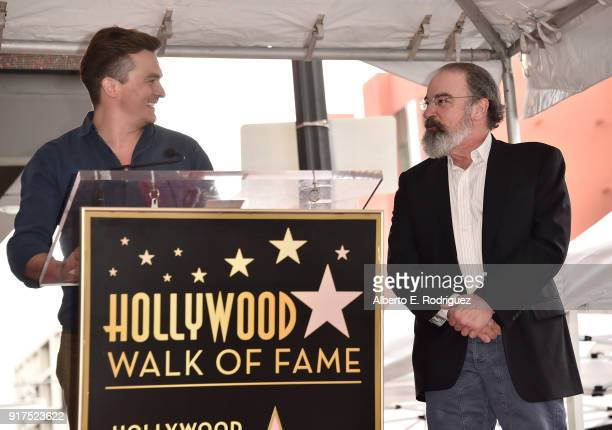 Actors Rupert Friend and Mandy Patinkin attend a ceremony honoring Mandy Patinkin with the 2629th star on the Hollywood Walk of Fame on February 12...