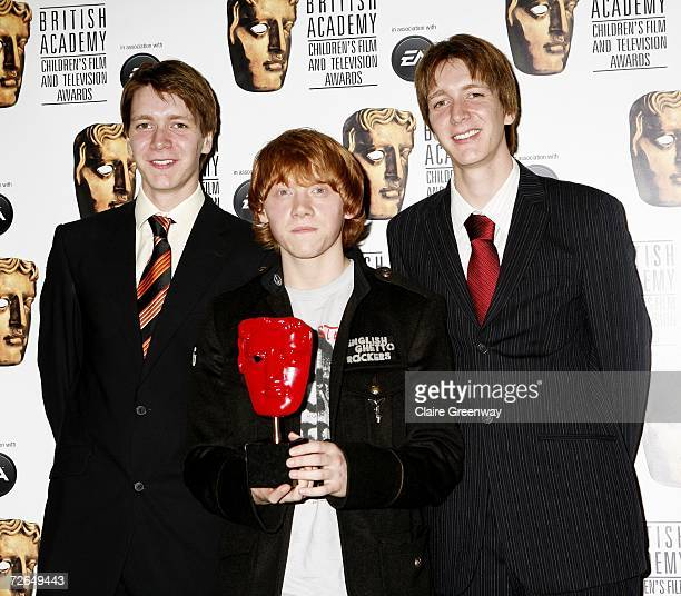 Actors Rupert Grint and Oliver and James Phelps pose in the awards room with the BAFTA Kid's Vote in association with Electronic Arts award for Harry...
