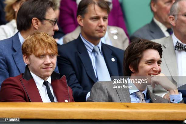 Actors Rupert Grint and Oliver Phelps watch the third round match between Andy Roddick of the United States and Feliciano Lopez of Spain on Day Five...