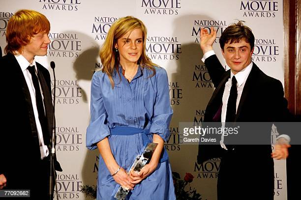 Actors Rupert Grint Emma Watson and Daniel Radcliffe pose in the awards room with the Best Family Film award for Harry Potter and the Order of the...