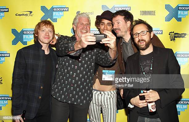 Actors Rupert Grint Ron Perlman Robert Sheehan director Antoine BardouJacquet and writer Dean Craig attend the premiere of Moonwalkers during the...