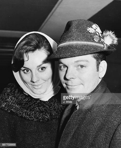 Actors Russ Tamblyn and his wife Elizabeth Kempton arriving in Britain to attend the Royal Film Performance of 'West Side Story', pictured at London...