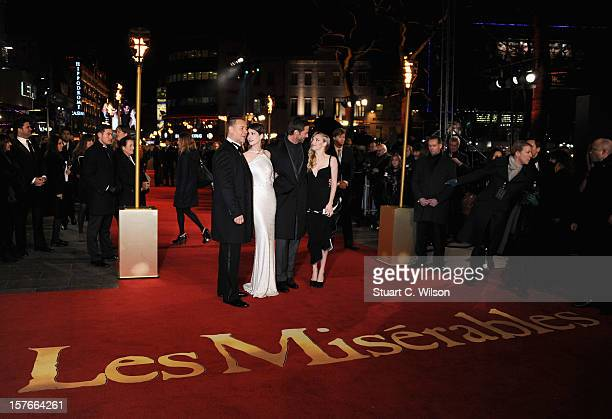 Actors Russell Crowe Anne Hathaway Hugh Jackman and Amanda Seyfriend attend the 'Les Miserables' World Premiere at the Odeon Leicester Square on...