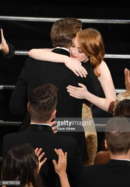 Actors Ryan Gosling and Emma Stone embrace in the audience during the 89th Annual Academy Awards at Hollywood Highland Center on February 26 2017 in...