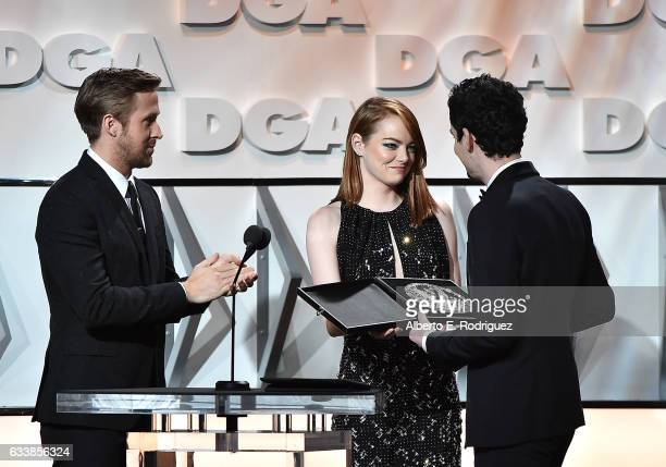 "Actors Ryan Gosling and Emma Stone present the Feature Film Nomination Plaque for ""La La Land"" to director Damien Chazelle onstage during the 69th..."