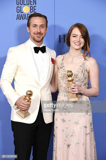 Actors Ryan Gosling and Emma Stone winners for Best Actor and Best Actress in a Musical or Comedy Film for 'La La Land' pose in the press room during...