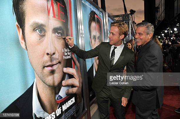 Actors Ryan Gosling and George Clooney arrive at the Ides Of March Los Angeles Premiere held at AMPAS Samuel Goldwyn Theater on September 27 2011 in...