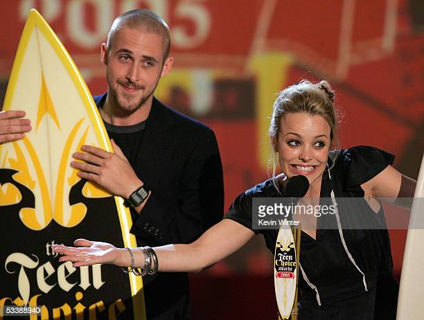 Actors Ryan Gosling and Rachel McAdams accept the Choice Movie Chemistry Award onstage at the 2005 Teen Choice Awards held at Gibson Amphitheatre at...