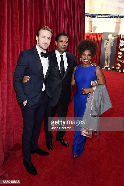 Actors Ryan Gosling Denzel Washington and Pauletta Washington attend The 23rd Annual Screen Actors Guild Awards at The Shrine Auditorium on January...