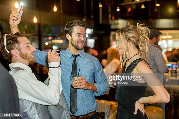 Actors Ryan Gunnarson Aqueela Zoll conduct an interview as they attend the Premiere Of Studio 71's 'Rush Inspired By Battlefield' after party at...