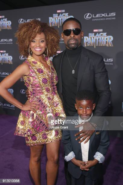 Actors Ryan Michelle Bathe Sterling K Brown and son Andrew Brown at the Los Angeles World Premiere of Marvel Studios' BLACK PANTHER at Dolby Theatre...