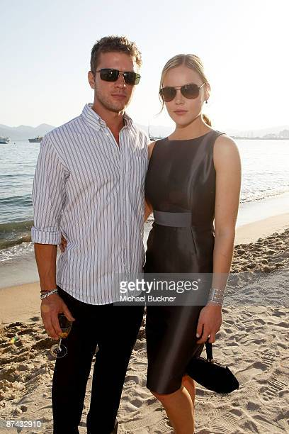 Actors Ryan Phillippe and Abbie Cornish attend The Bang Bang Club Cocktail Reception held at the La Plage du Petit Club Croisette Beach during the...