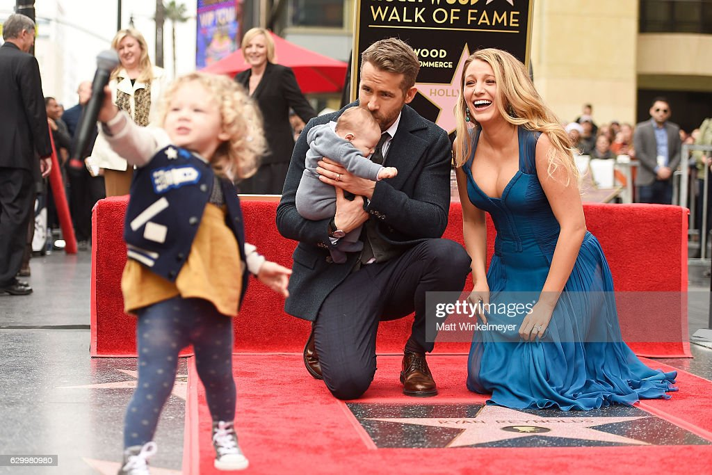 Actors Ryan Reynolds (L) and Blake Lively pose with their daughters as Ryan Reynolds is honored with star on the Hollywood Walk of Fame on December 15, 2016 in Hollywood, California.