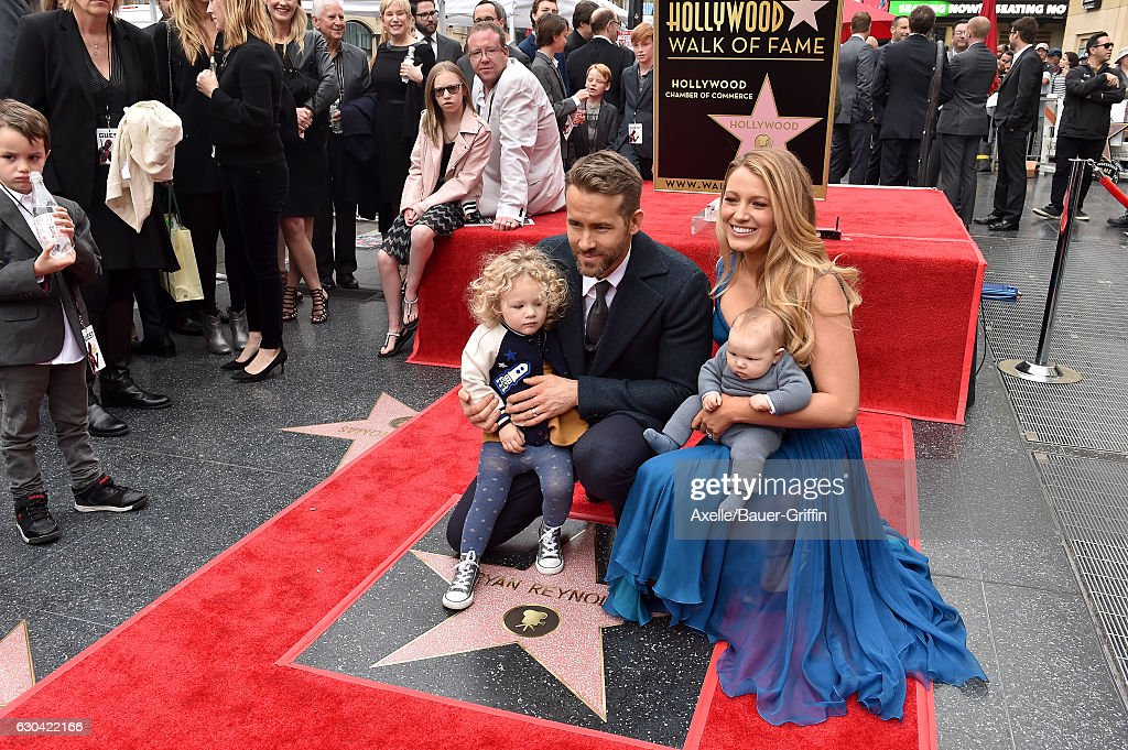 Actors Ryan Reynolds and Blake Lively with daughters James Reynolds and Ines Reynolds attend the ceremony honoring Ryan Reynolds with a Star on the Hollywood Walk of Fame on December 15, 2016 in Hollywood, California.