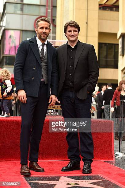 Actors Ryan Reynolds and Nathan Fillion attend a ceremony honoring Ryan Reynolds with a star on the Hollywood Walk of Fames on December 15 2016 in...