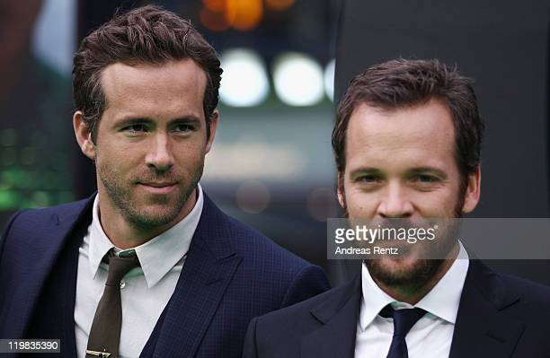 Actors Ryan Reynolds and Peter Sarsgaard attend the 'Green Lantern' Germany Premiere at CineStar on July 25 2011 in Berlin Germany