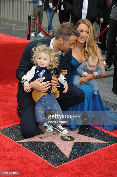 Actors Ryan Reynolds, Blake Lively and daughters attend the ceremony that honored Reynolds with a star on the Hollywood Walk of Fame on December 15,...