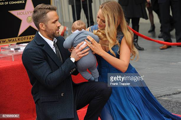 Actors Ryan Reynolds Blake Lively and daughters pose for a photo as Reynolds is honored with a star on the Hollywood Walk of Fame on December 15 2016...