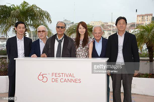 Actors Ryo Kase Tadashi Okuno director Abbas Kiarostami and Rin Takanashi pose at the 'Like Someone In Love' Photocall during the 65th Annual Cannes...