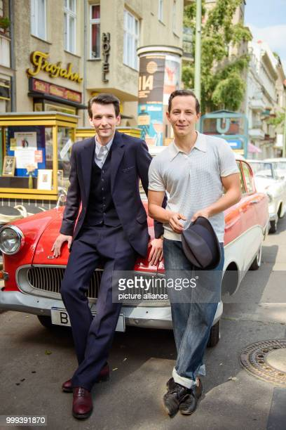 Actors Sabin Tambrea and Trystan Putter leaning on an Opel Rekord from the 1950s for a joint portrait on the set of the ZDF series 'Ku'damm 59' in...