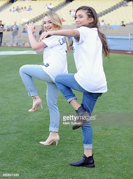 Actors Sabrina Carpenter and Rowan Blanchard on the field before the game between the Colorado Rockies and Los Angeles Dodgers at Dodger Stadium on...