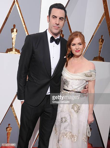 Actors Sacha Baron Cohen and Isla Fisher arrive at the 88th Annual Academy Awards at Hollywood & Highland Center on February 28, 2016 in Hollywood,...