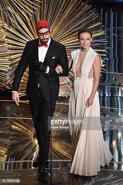 Actors Sacha Baron Cohen and Olivia Wilde walk onstage during the 88th Annual Academy Awards at the Dolby Theatre on February 28 2016 in Hollywood...