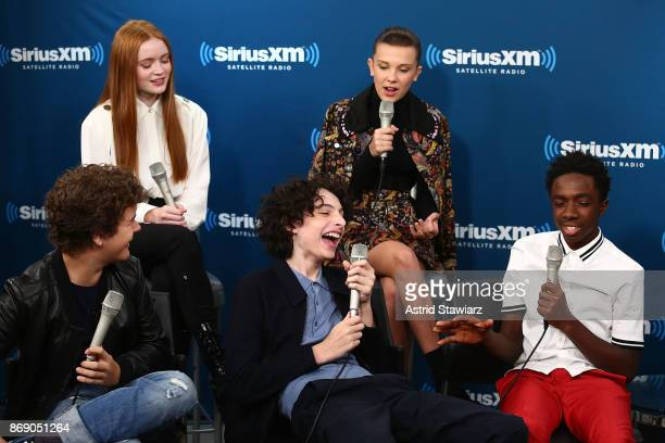 Actors Sadie Sink Millie Bobby Brown Caleb McLaughlin Finn Wolfhard and Gaten Matarazzo attend SiriusXM's 'Town Hall' cast of Stranger Things on...