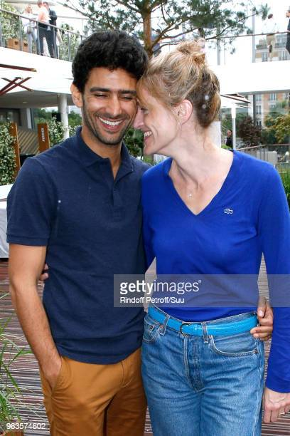 Actors Salim Kechiouche and his companion Olivia Cote attend the 2018 French Open Day Three at Roland Garros on May 29 2018 in Paris France