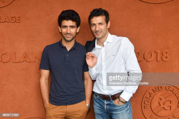 Actors Salim Kechiouche and Kamel Belghazi attend the 2018 French Open Day three at Roland Garros on May 29 2018 in Paris France