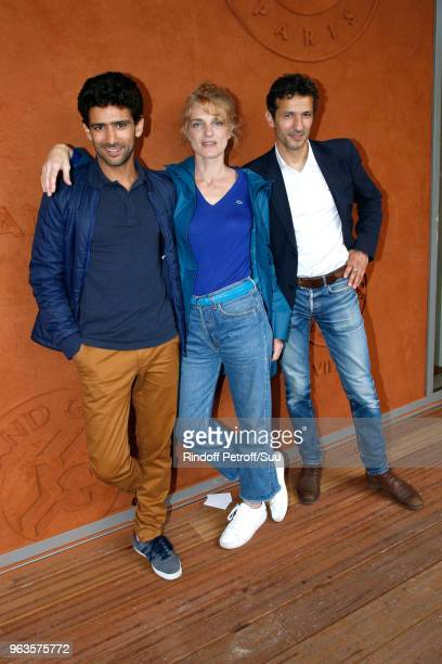 Actors Salim Kechiouche his companion Olivia Cote and Kamel Belghazi attend the 2018 French Open Day Three at Roland Garros on May 29 2018 in Paris...