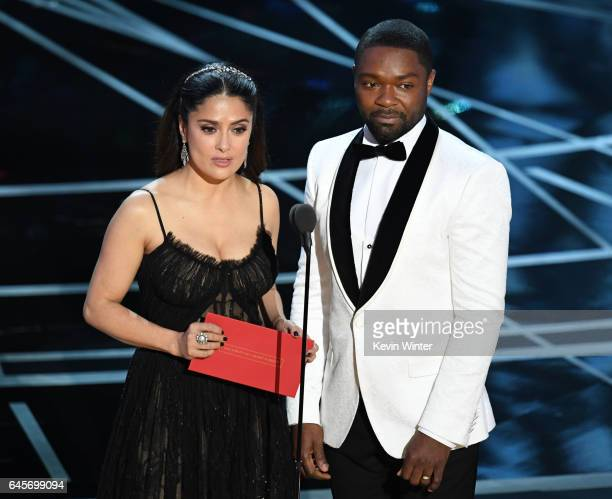 Actors Salma Hayek and David Oyelowo speak onstage during the 89th Annual Academy Awards at Hollywood Highland Center on February 26 2017 in...