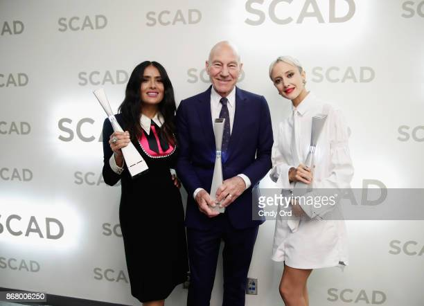 Actors Salma Hayek Patrick Stewart and Andrea Riseborough pose backstage with awards at Lucas Theatre during 20th Anniversary SCAD Savannah Film...