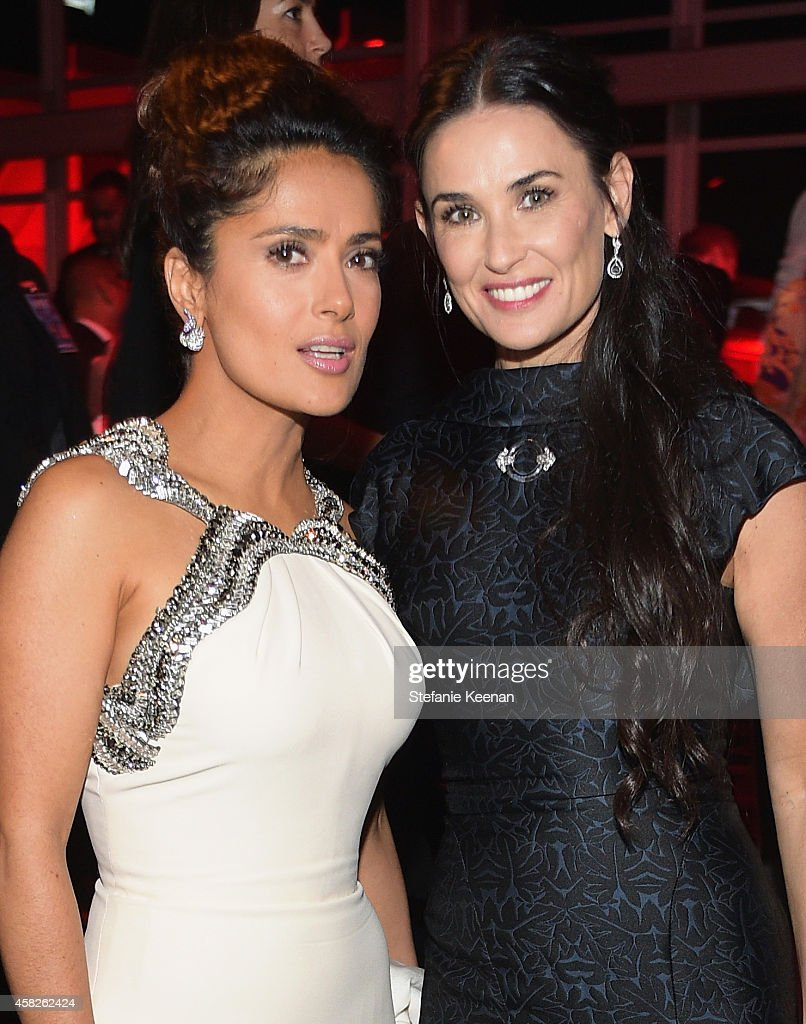 Actors Salma Hayek Pinault, wearing Gucci, and Demi Moore attend the 2014 LACMA Art + Film Gala honoring Barbara Kruger and Quentin Tarantino presented by Gucci at LACMA on November 1, 2014 in Los Angeles, California.