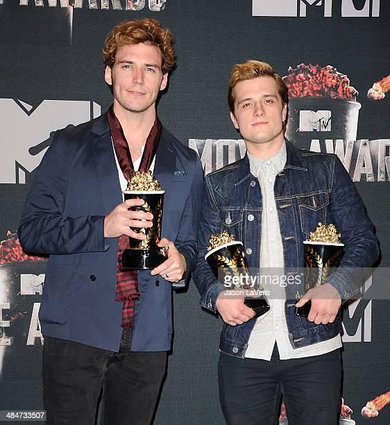 Actors Sam Claflin and Josh Hutcherson pose in the press room at the 2014 MTV Movie Awards at Nokia Theatre LA Live on April 13 2014 in Los Angeles...