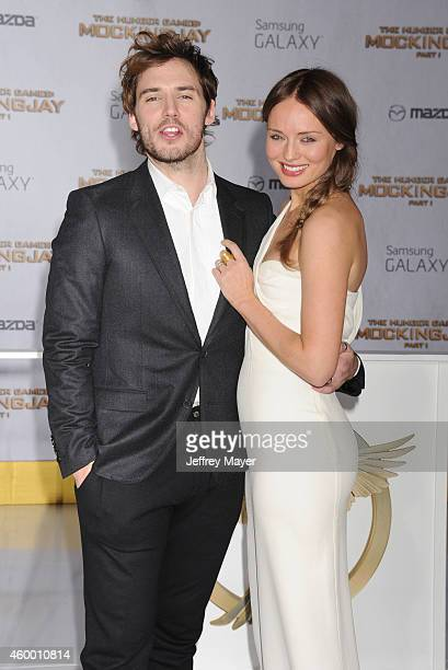 Actors Sam Claflin and Laura Haddock arrive at the 'The Hunger Games Mockingjay Part 1' Los Angeles Premiere at Nokia Theatre LA Live on November 17...