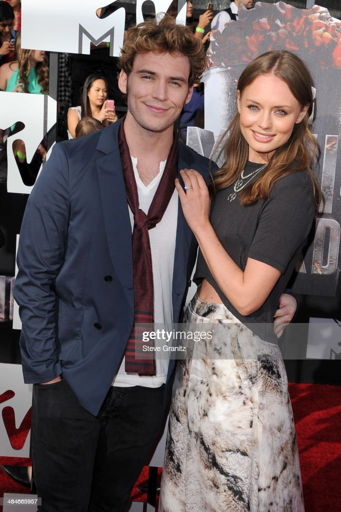 Actors Sam Claflin (L) and Laura Haddock attend the 2014 MTV Movie Awards at Nokia Theatre L.A. Live on April 13, 2014 in Los Angeles, California.