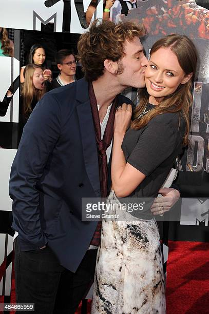 Actors Sam Claflin and Laura Haddock attend the 2014 MTV Movie Awards at Nokia Theatre LA Live on April 13 2014 in Los Angeles California