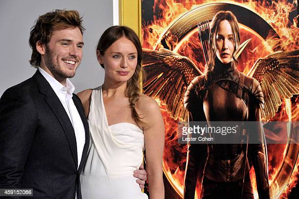 Actors Sam Claflin and Laura Haddock attend 'The Hunger Games Mockingjay Part 1' Los Angeles Premiere at Nokia Theatre LA Live on November 17 2014 in...