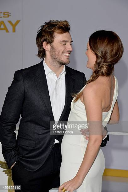 Actors Sam Claflin and Laura Haddock attend The Hunger Games Mockingjay Part 1 Los Angeles Premiere at Nokia Theatre LA Live on November 17 2014 in...