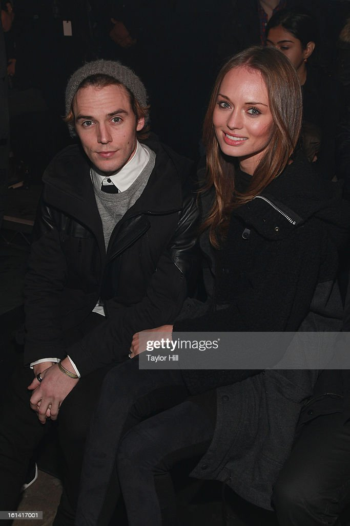 Actors Sam Claflin and Laura Haddock attend the Y-3 Fall 2013 Mercedes-Benz Fashion Show at 80 Essex Street on February 10, 2013 in New York City.