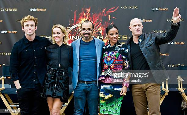 Actors Sam Claflin Jena Malone Jeffrey Wright Meta Golding and Bruno Gunn attend the The Hunger Games Catching Fire Victory mall tour at Cherry Hill...