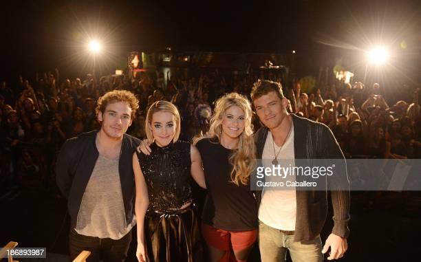Actors Sam Claflin Jena Malone Stephanie Leigh Schlund and Alan Ritchson attend 'The Hunger Games Catching Fire' Victory Tour enter caption here at...