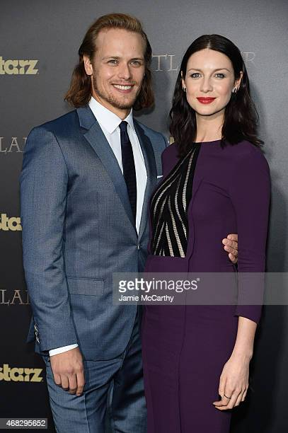 Actors Sam Heughan and Caitriona Balfe attend the Outlander midseason New York premiere at Ziegfeld Theater on April 1 2015 in New York City