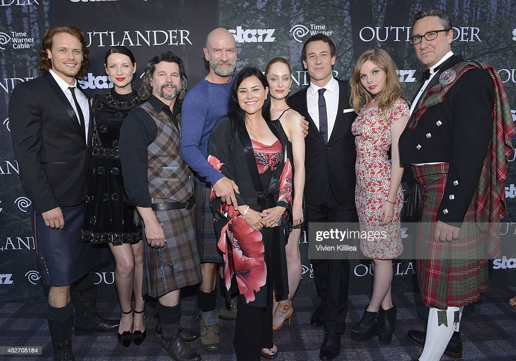 Actors Sam Heughan and Caitriona Balfe, executive producer Ronald S. Moore, actor Graham McTavish, author Diana Gabaldon and actors Lotte Verbeek, Tobias Menzies and Nell Hudson and managing director of Starz Carmi Zlotnik attend the Starz Series 'Outlander' Premiere - Comic-Con International 2014 at Spreckels Theatre on July 25, 2014 in San Diego, California.