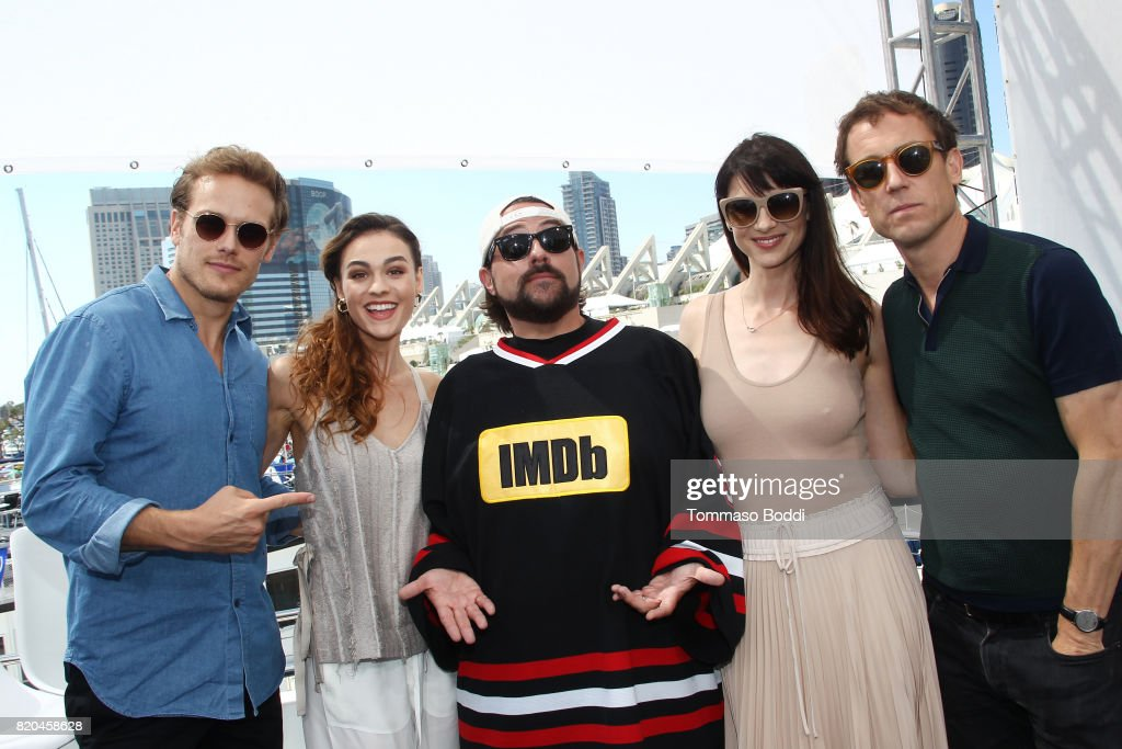 Actors Sam Heughan, Sophie Skelton, host Kevin Smith, actors Caitriona Balfe and Tobias Menzies on the #IMDboat at San Diego Comic-Con 2017 at The IMDb Yacht on July 21, 2017 in San Diego, California.