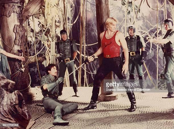 Actors Sam J Jones and Timothy Dalton in a scene from the film 'Flash Gordon' 1980