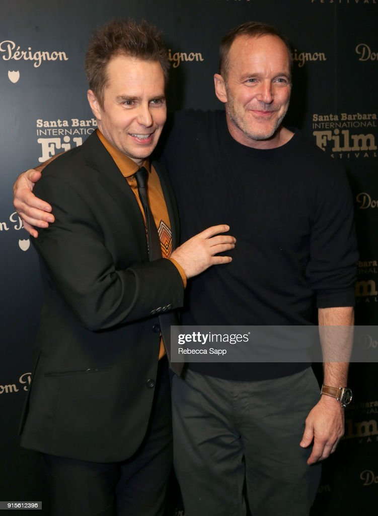 Actors Sam Rockwell and Clark Gregg pose backstage at The American Riviera Award Honoring Sam Rockwell during The 33rd Santa Barbara International Film Festival at Arlington Theatre on February 7, 2018 in Santa Barbara, California.